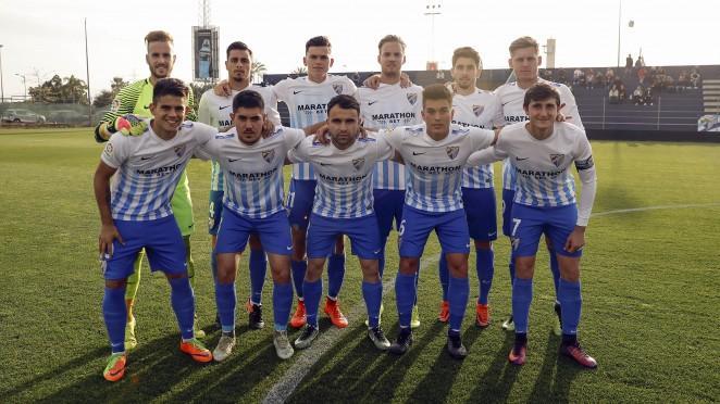 Aarón, a la izquierda, antes de un partido con el filial del Málaga.